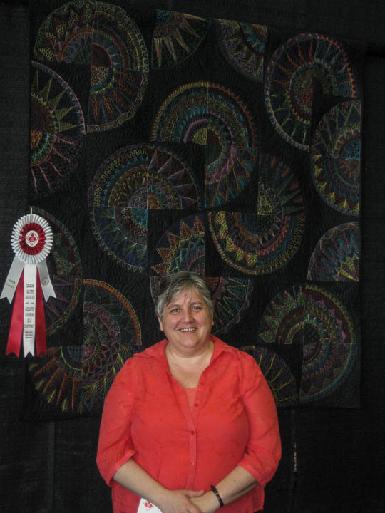 long arm quilt with prize winning ribbon