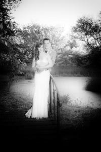 bride-and-groom-posing-on-bridge