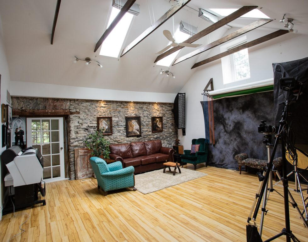 interior view of portrait studio with skylights, and comfortable lounge