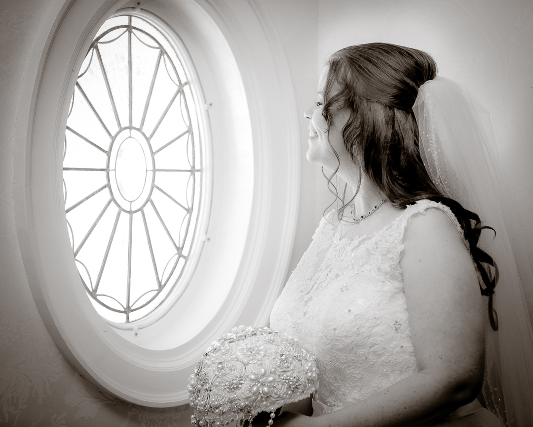 happy bride looking out window