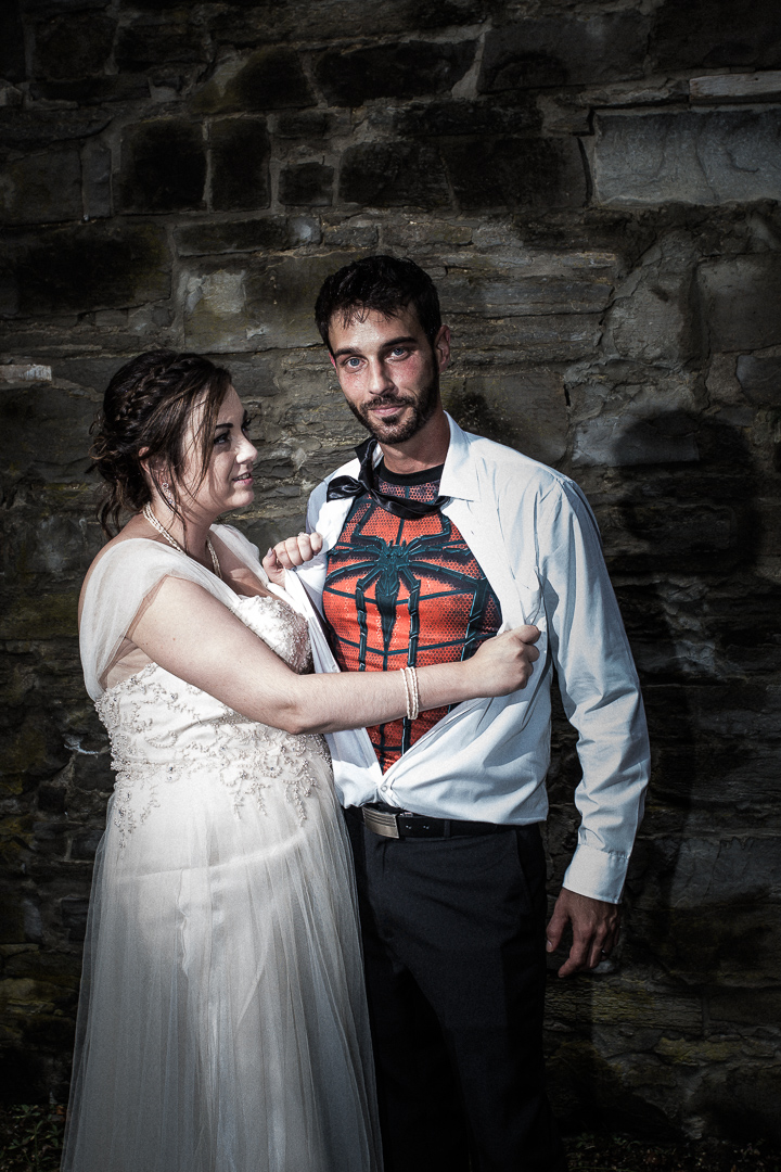 bride opens groom shirt to reveal superhero costume