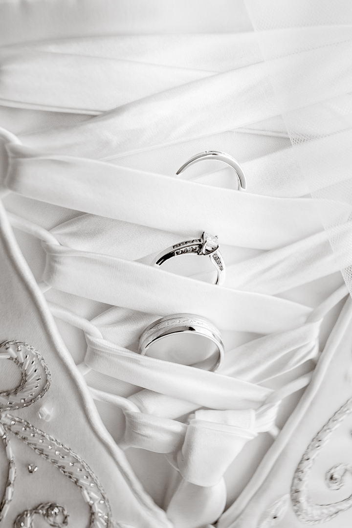 wedding rings tucked in brides gown